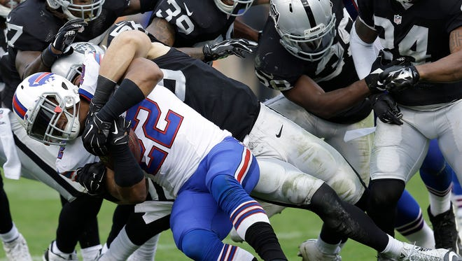 Buffalo Bills running back Fred Jackson is tackled by Oakland Raiders linebacker Miles Burris during the first half.