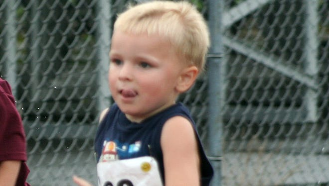 In this 2009 file photo provided by the Kowalski family, Chase Kowalski, at 2½ years old, runs in a race at Bethel High School in Bethel, Conn.