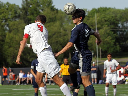 City High's Victor Brown-Rodriguez goes up for a header during the Little Hawks' substate semifinal game against Pleasant Valley on Wednesday, May 25, 2016.
