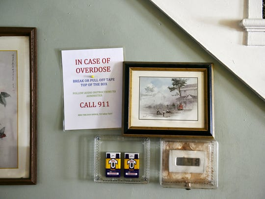 Two doses of naloxone, a drug that effectively reverses an opioid overdose, are encased next to the living room thermostat of a Linden Avenue recovery house operated by Sees-the-Day. Recovery homes are not required to have the antidote, even though many do.