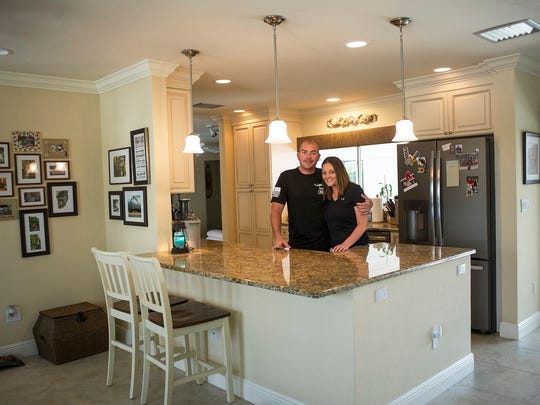 """Don and Lauren Ross pose for a photograph at their new home on Marco Island, Fla., on Tuesday, April 4, 2017. The recently married Naples couple was featured on HGTV's """"Island Life"""" as they searched for a home on Marco Island, their hometown."""