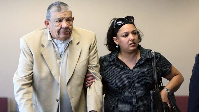 Isaac Duarte, left, leaves 243rd District Court with his daughter after pleading guilty to murder in connection with the fatal stabbing of his 66-year-old wife in 2014.