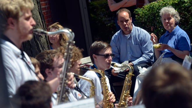 Brad and Kathleen Kerr of Spring Garden Township enjoy lunch on a warm afternoon in the Cherry Lane Courtyard as the York Suburban Middle School and High School Jazz Bands open the 2014 Box Lunch Revue, Thursday May 1,  2014. The Box Lunch Revue features free live music every Tuesday and Thursday through August, for a list of upcoming acts visit www.yorkcity.org/boxlunchrevue John A. Pavoncello - jpavoncello@yorkdispatch.com