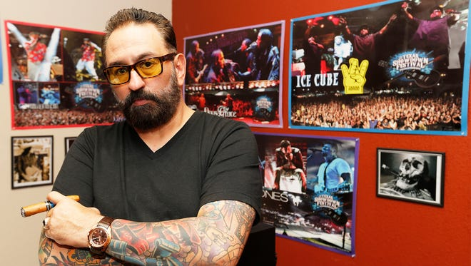 George Galindo, CEO and founder of the Texas Showdown Festival, stands in his office at House of Pain Tattoo, 1550 Hawkins Blvd. He is preparing for the seventh annual Texas Showdown Festival, which will be Sept. 23-25 at the El Paso County Coliseum. The festival has been ranked one of the top five best annual tattoo festivals in the world by Tattoosday, a top tattoo blog, and will feature Snoop Dogg performing as Snoopadelic as the headliner.