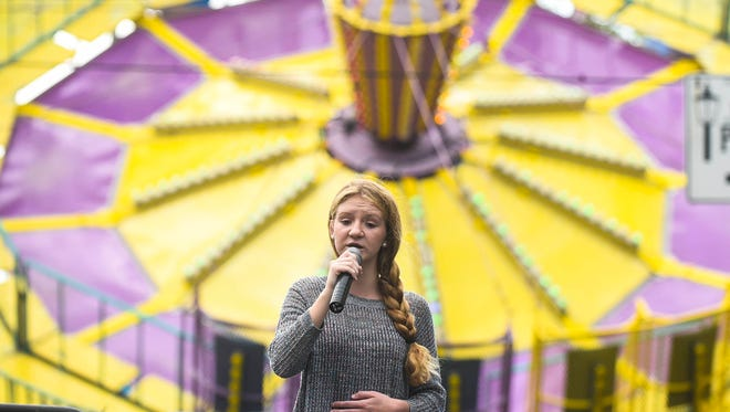 Tiffany Degood performs on the Marion's Hometown Talent Stage during the 2016 Marion Popcorn Festival.
