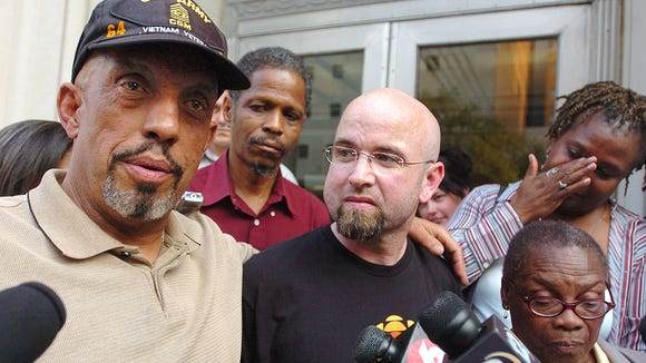 Thomas Moore, brother of Charles Eddie Moore, left, stands with Alvin Sykes, CBC documentary filmmaker David Ridgen, center, Donna Collins and Thelma Collins, sister of Hezekiah Dee, outside the former Eastland Federal Courthouse on June 14, 2007, after a jury found reputed Klansman James Ford Seale guilty of kidnapping and conspiracy in the deaths of Dee and Charles Eddie Moore.