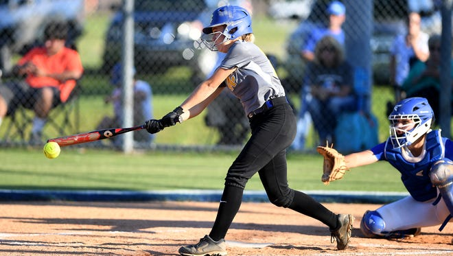 McNairy Central's Allison Sweat (15) swings at a pitch during Tuesday's game against Chester County. McNairy won 7-5.