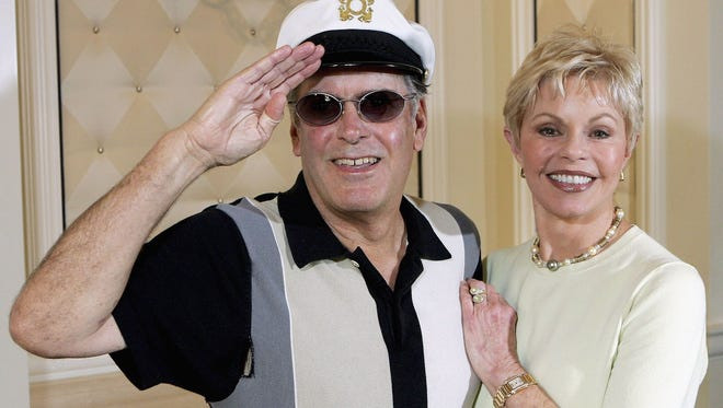 """""""Captain"""" Daryl Dragon and his wife Toni Tennille of the music duo The Captain and Tennille, pose at the Video Software Dealers Association's annual home video convention at the Bellagio on July 27, 2005 in Las Vegas. After the couple divorced in 2014, Tennille moved to Florida. She said on Facebook she is returning to Prescott, Ariz., at the end of July 2017."""