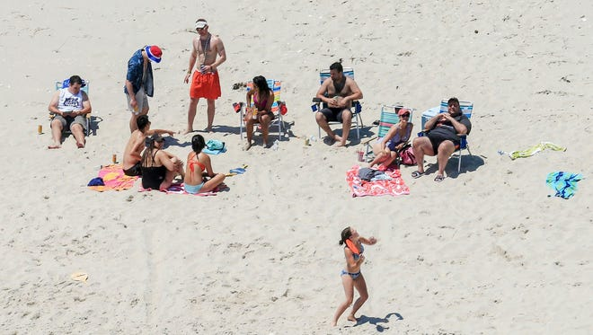 New Jersey Gov. Chris Christie, right, at Island Beach State Park.