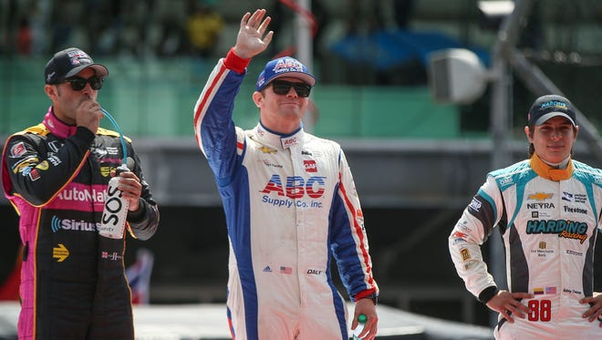 Conor Daly (center) will race in this month's Indy 500 and then get behind the wheel of a stock car in August.
