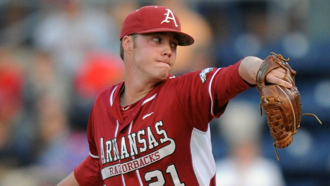 Arkansas' Trey Killian (21) pitches against Mississippi during a game last season in Oxford, Miss.