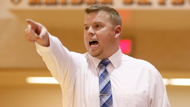 Frankfort head coach Joe Marsh calls out a play as the Hot Dogs face West Lafayette in the Franciscan Health Hoops Classic Tuesday, November 14, 2017, at Harrison High School. West Lafayette defeated Frankfort 63-28.