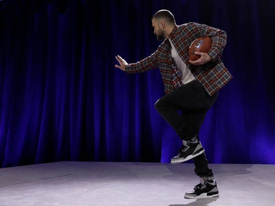 Justin Timberlake does a Heisman pose during a news conference for the NFL Super Bowl 52 football game halftime show Thursday, Feb. 1, 2018, in Minneapolis.