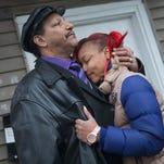 LaTonya Jones, the daughter of Bettie Jones, gets comfort from her father Garry Mullen during a vigil to honor Bettie Jones, a mother of 5.