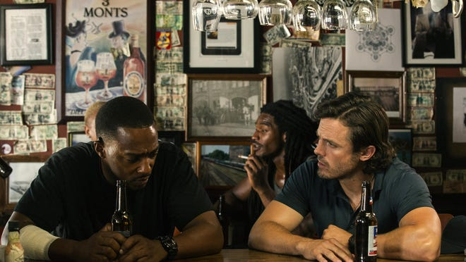 """Anthony Mackie, left, and Casey Affleck star in """"Triple 9."""""""