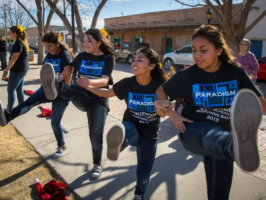 Members of the Centennial High School Band's Color Guard dance on Mesilla Plaza on Saturday. The Centennial Band conducted a 12 hour music marathon at the Farmers & Crafts Market, Mesilla Plaza and the Pan American Center to raise money for the school's music program.