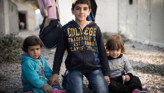 Syrian children at the Kara Tepe refugee camp in Lesvos, Greece, as captured by Tucson photographer Jade Beall.