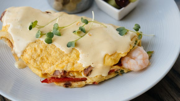 Brick & Spoon will now be serving brunch specialties such as this killer Creole omelet for dinner.