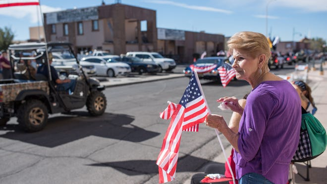 Attendees watch the 2017 Las Cruces Veterans Day Parade in the city's downtown.