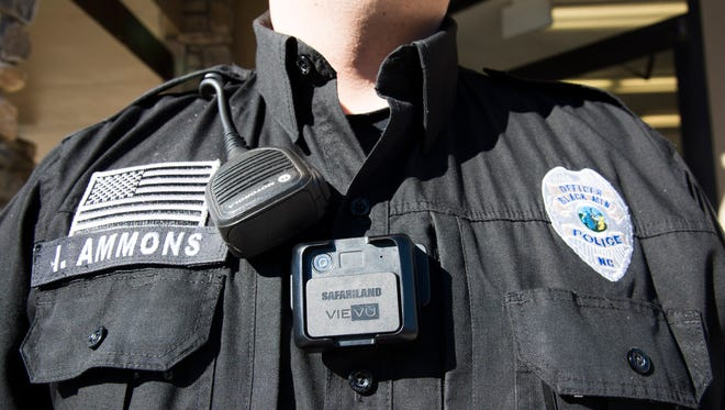 Black Mountain police officer Ian Ammons models the new body cameras officers will wear.