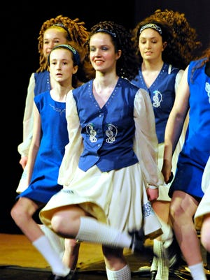 Irish dancer Mairead Howley, 17, of Minneapolis, performs with the St. Paul Irish Dancers during a concert by Ring of Kerry on Friday at the Paramount Theatre.