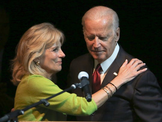 """Jill Biden greets her husband, Joe Biden, after introducing him as she delivers the opening remarks during an Imagine Delaware forum """"Protecting Our Children"""" at Cab Calloway School of the Arts in Wilmington on Friday."""