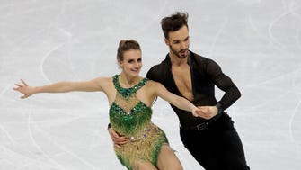 Gabriella Papadakis and Guillaume Cizeron (FRA) perform in the short dance event.