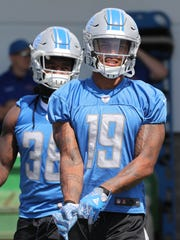 Lions running back Tion Green and receiver Kenny Golladay (19) get ready for practice July 31, 2017 in Allen Park.
