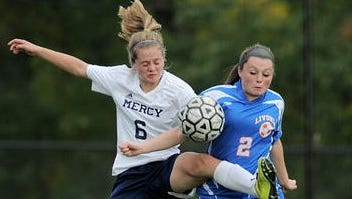 Mercy's Anna Doerr, left, reaches in to win the ball from Livonia's Julia McDevitt during a regular season game played at Our Lady of Mercy High School on Tuesday, October 7, 2014. Mercy handed Livonia it's first loss of the season with a 5-2 win.