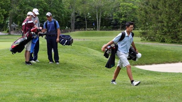 Nathan Han of Somers walks off the course after earning the Section 1 title in the final round of the boys golf tournament at Fenway Golf Club in Scarsdale Wednesday.