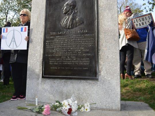 Vigil participants on Sunday embrace next to the Lafayette