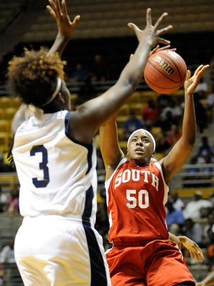 South's Amahni Upshaw (50) shoots against North's Rayven Pearson (3) during the AHSAA All-Star Week girl's basketball game at the Alabama State University Acadome in Montgomery, Ala. on Wednesday July 23, 2014.