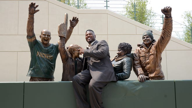 LeRoy Butler, credited with originating the Lambeau Leap,was the first to pose with the Lambeau Leap sculpture on Harlan Plaza during its unveiling  at Lambeau Field in 2014.