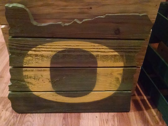 Kristi and Randy Syverson create art using weathered wood. This sign was inspired by their passion for the University of Oregon and Ducks football.