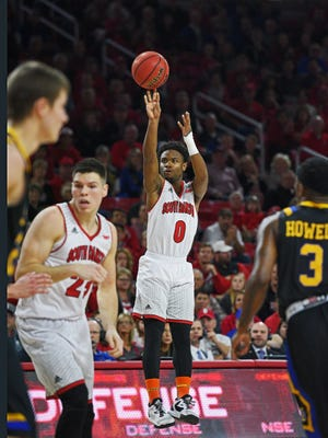 USD's Trey Dickerson (0) takes a shot during a game against SDSU Saturday, Feb. 11, 2017, at the Sanford Coyote Sports Center on the University of South Dakota campus in Vermillion, S.D. USD beat SDSU 91-89.