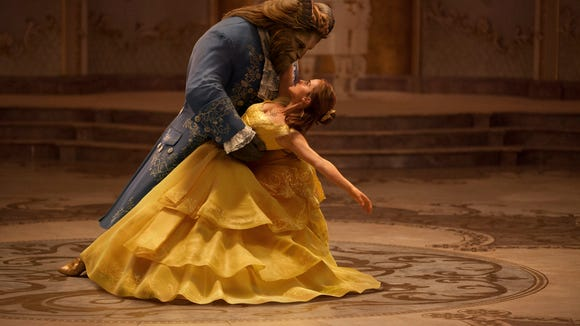The Beast (Dan Stevens) and Belle (Emma Watson) share