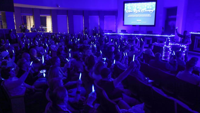 Attendees holds lights during the Blue Light Ceremony in remembrance of law enforcement officers who made the ultimate sacrifice at the Palm Desert City Hall, December 4, 2017.