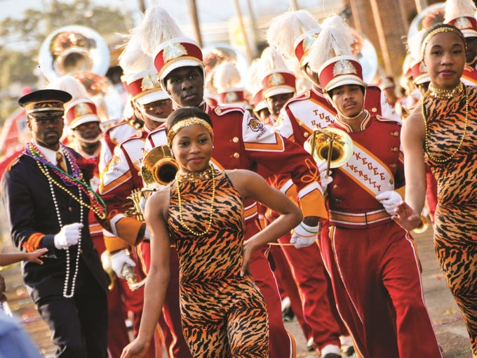 Vibrant floats and exuberant marching bands fill the