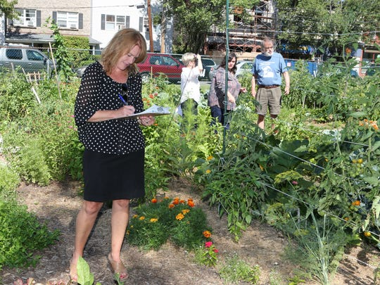 Judge Jen White, the mayor of the Village of Nyack, takes notes as the Nyack Community Garden held their annual contest July 23, 2015.  Five judges judged over 50 plots in five categories including Best Vegetable, Best Flowers, Best Maintained, Most Creative and Best Overall. This is 35th year that the contest was held.