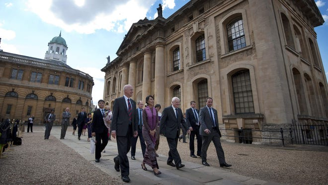 This file photo taken on June 19, 2012 shows Myanmar leader Aung San Suu Kyi as she leaves after visiting the Bodleian Libraries at Oxford University in Oxford, northwest of London.