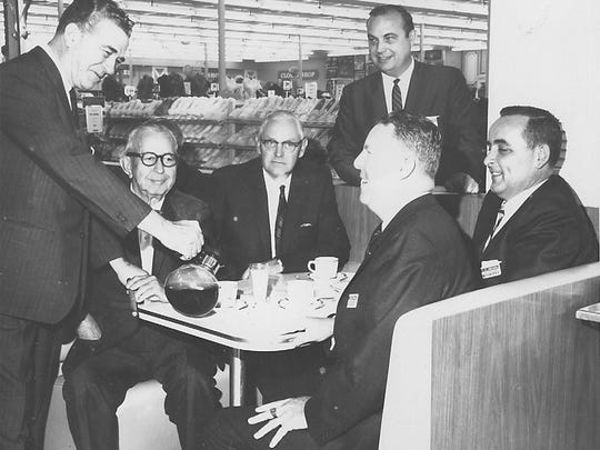 """In 1967: A group of Reno businessmen meet at the Woolworth store in Park Lane Mall. Clockwise from left, they are H.M. Swift, Dr. Bart Hood, Reno Mayor Roy Bankofier, """"Chuck"""" Charlton, H.P. Smith and Paul O'Driscoll."""
