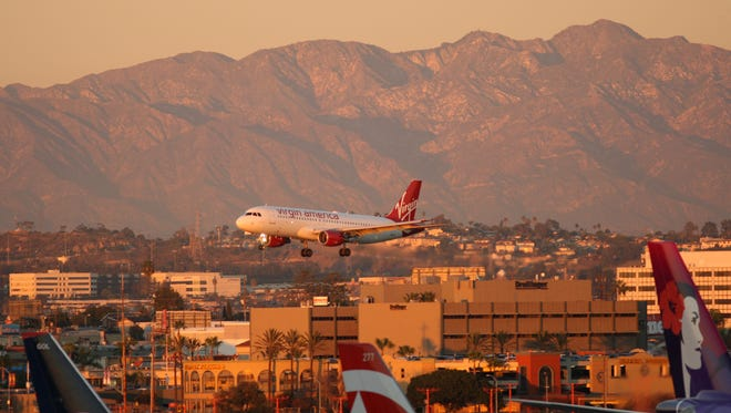 A Virgin America jet lands at LAX on Nov. 26, 2014.