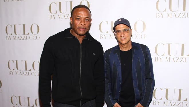 "Dr. Dre (L) and Jimmy Iovine attend the ""CULO By Mazzucco"" Launch at the Tony Shafrazi Gallery on October 9, 2011 in New York City."