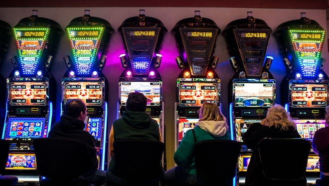Customers try their luck at the Menominee Casino in Keshena.