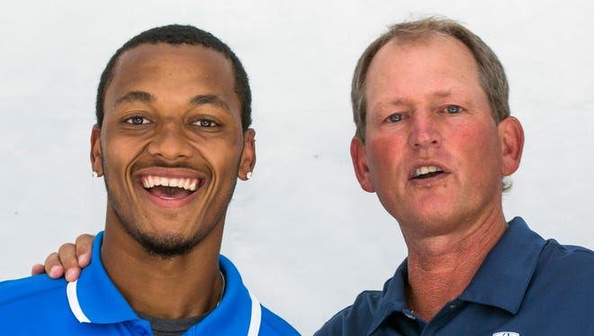 UCLA quarterback Brett Hundley, left, poses for photo with former UCLA coach Rick Neuheisel at the 2014 Pac-12 NCAA college football media days at Paramount Studios in Los Angeles, Thursday, July 24, 2014.
