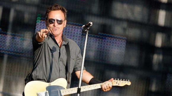 US rock star Bruce Springsteen performs on stage at the Stade de Suisse stadium in Berne, Switzerland, Tuesday, June 30, 2009. (AP Photo/Keystone, Peter Klaunzer)