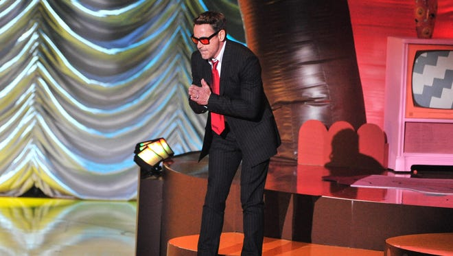 Robert Downey Jr. accepts the MTV Generation Award onstage during the 2015 MTV Movie Awards on April 12.