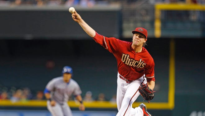 Arizona Diamondbacks starting pitcher Archie Bradley (25) throws in the first inning of their MLB game against the Texas Rangers Wednesday, April 22, 2015  in Phoenix, Ariz.