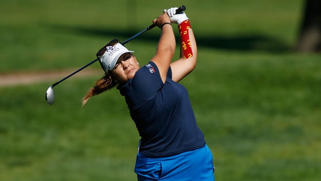 Lizette Salas watches her shot from the eighth fairway during the first round of the Meijer LPGA Classic  presented by Kraft at Blythefield Country Club on July 23, 2015 in Grand Rapids, Michigan.