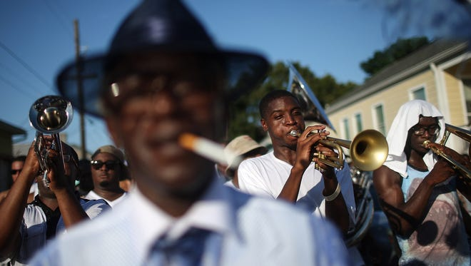 Revelers march during the Valley of the Silent Men second line parade on Aug. 23, 2015 in New Orleans. Traditional second line parades are put on by social aid and pleasure clubs organized by neighborhoods in the city.
